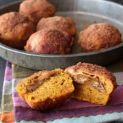 Biscoff Filled Pumpkin Mini Muffins are coated with cinnamon sugar and perfect for all! From HandletheHeat.com